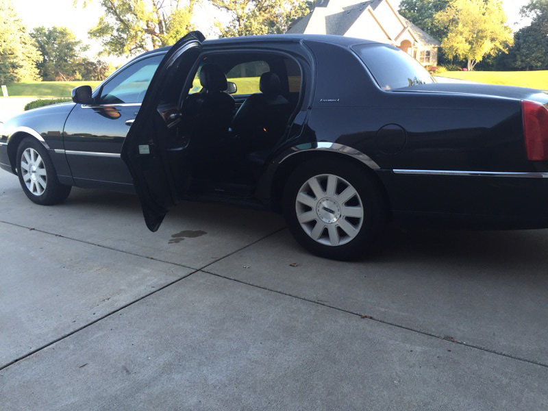 Lincoln town car with open door transportation mn