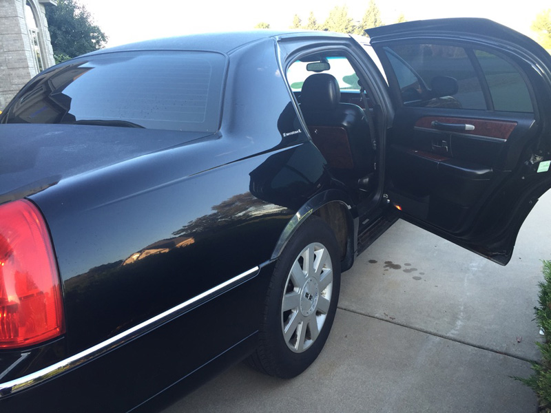 Lincoln town car back end with open door